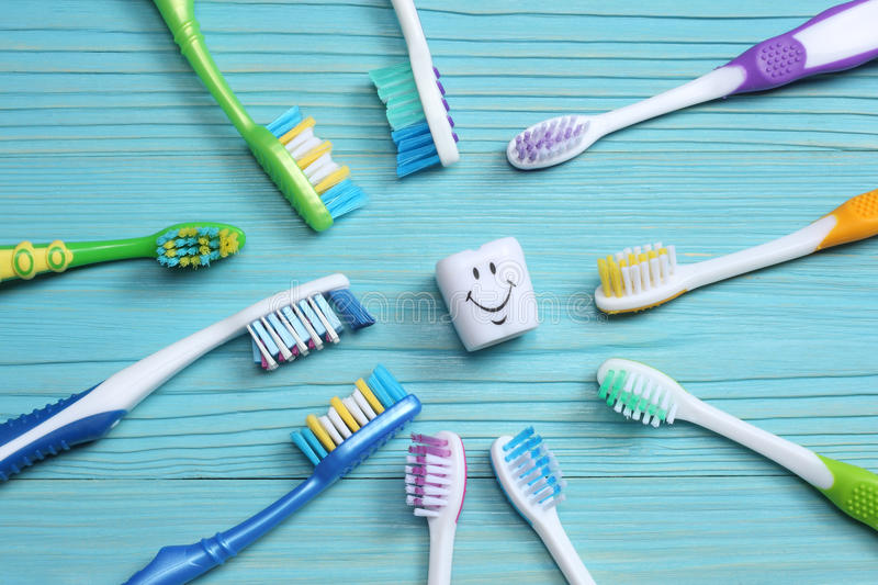 Toothbrush tooth-brush on wood table. top view royalty free stock photography