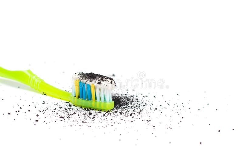 Toothbrush with toothpaste with the addition of activated carbon and Babmuk coal on a white background, for the treatment of gums. Of teeth and whitening, close royalty free stock images