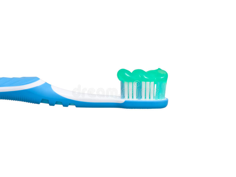 Toothbrush with toothpaste on. Side view of a tooth brush with toothpaste applied stock photo