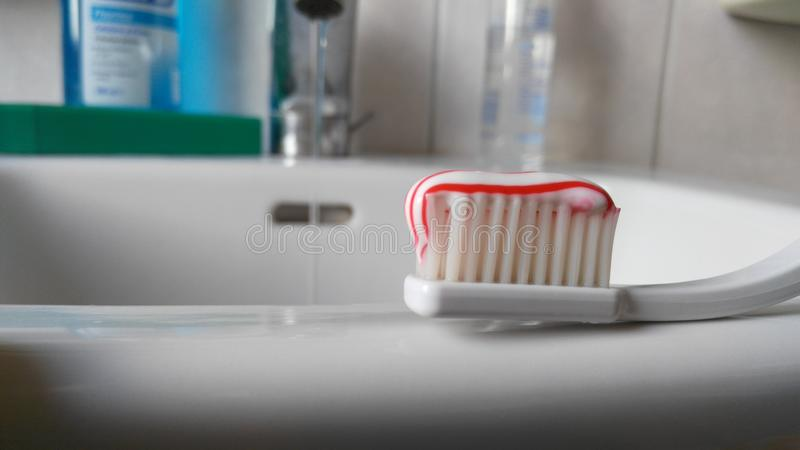 Download Toothbrush With Toothpaste On A Sink Stock Photo - Image of teeth, brushing: 86620546