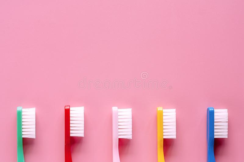 Toothbrush used for cleaning the teeth on pink background stock image