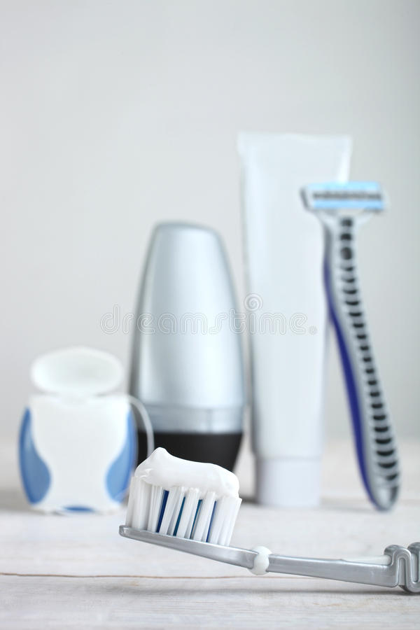 Toothbrush with paste. Toothbrush on a wooden table on the background of means for self-care stock photo