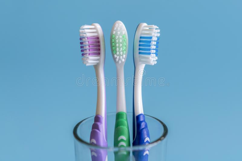 Toothbrushes on blue background. Flat lay composition with manual toothbrushes on color background, close up.  stock images