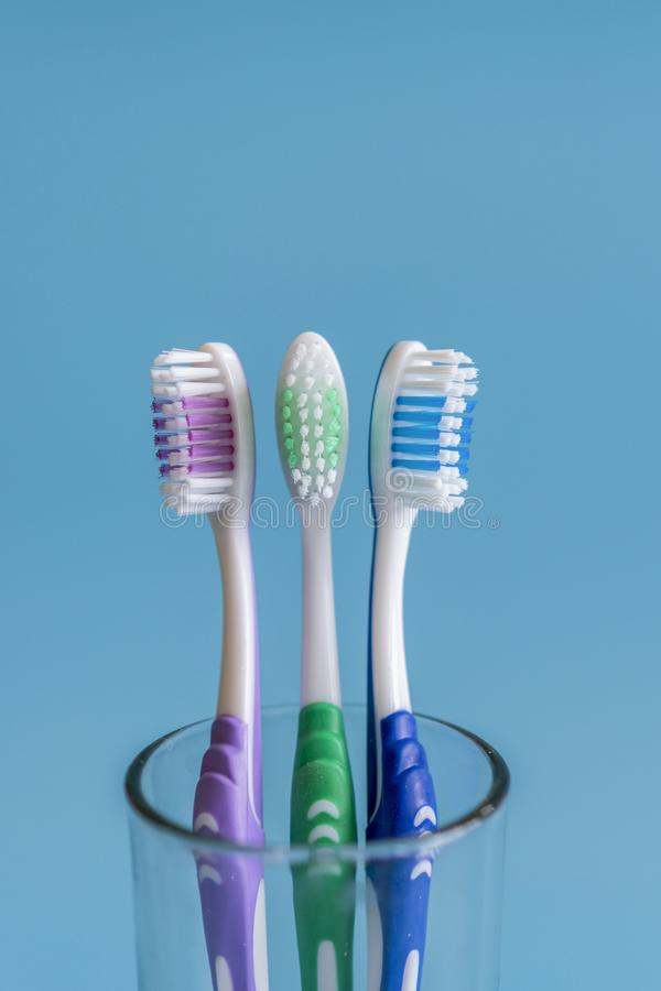Toothbrushes on blue background. Flat lay composition with manual toothbrushes on color background, close up. vertical photo.  stock photography