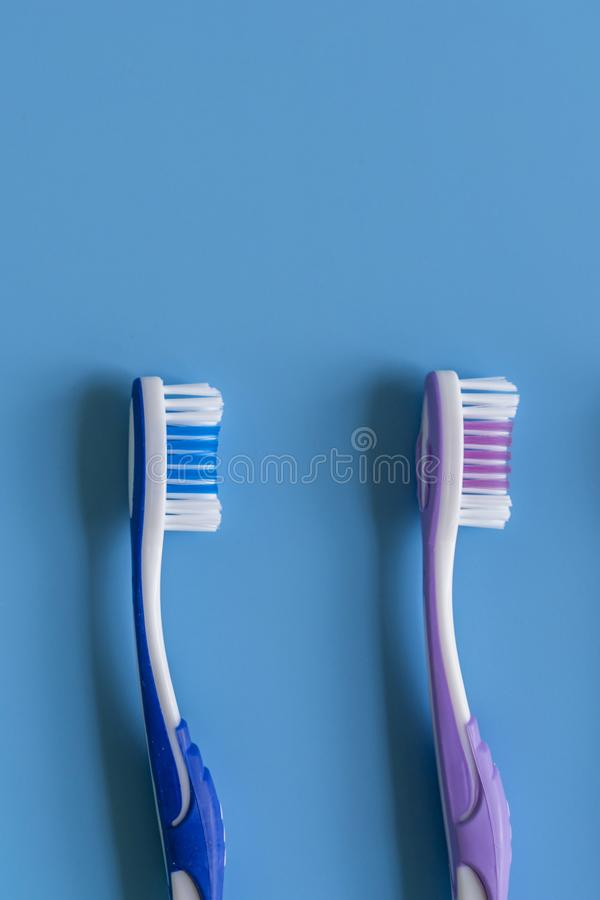 Toothbrushes on blue background. Flat lay composition with manual toothbrushes on color background, close up. copy space. vertical. Photo stock images