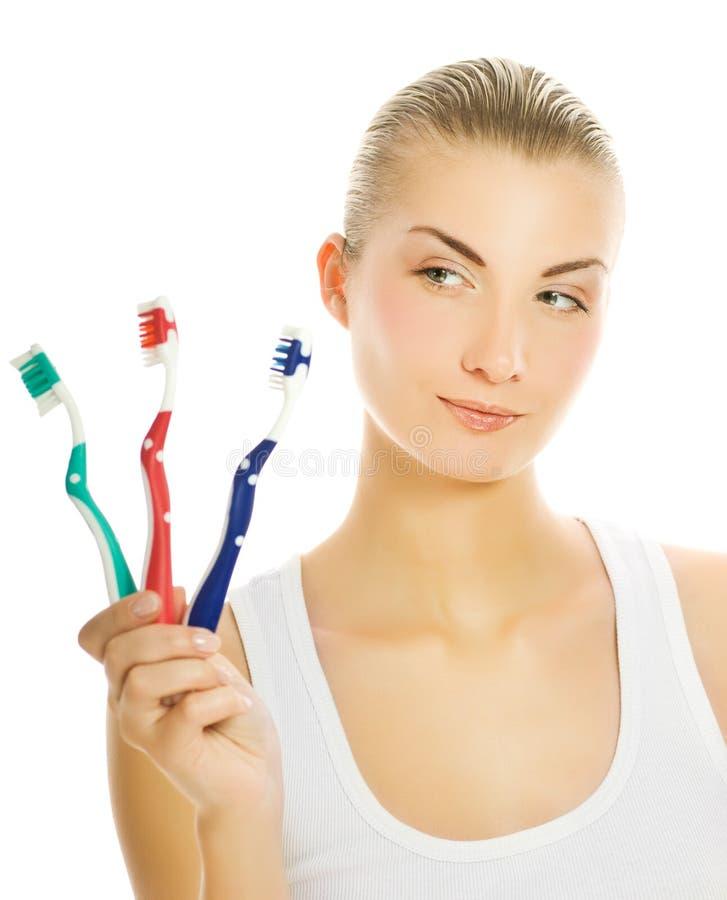 Toothbrushes da mulher foto de stock