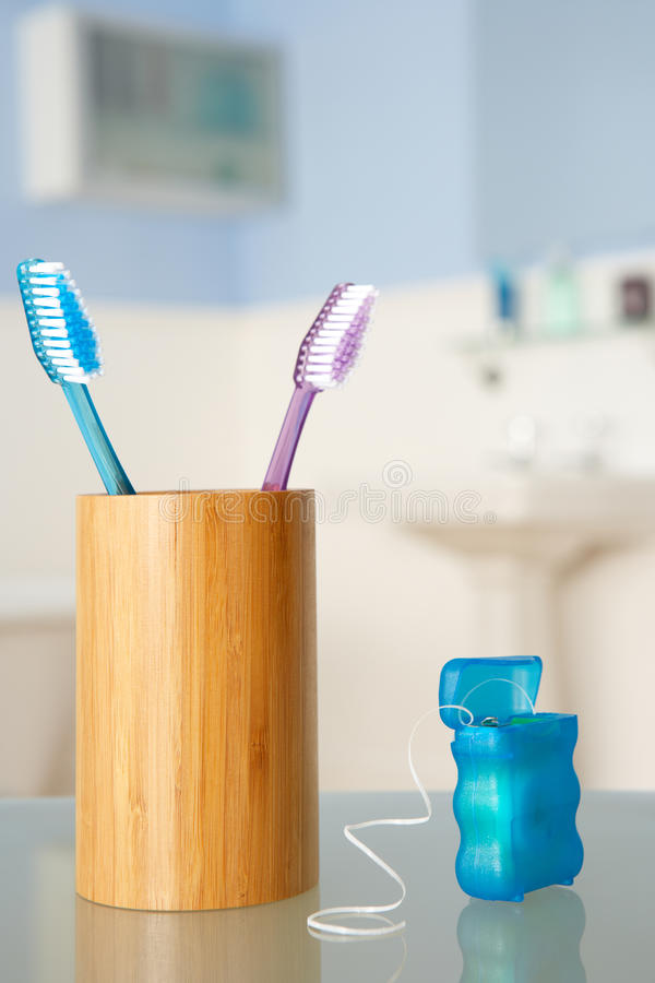 Toothbrushes and dental floss royalty free stock photos