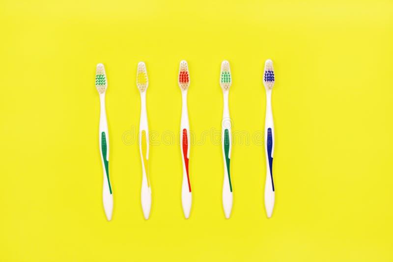 Toothbrushes na żółtym tle obraz royalty free
