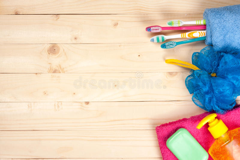 Toothbrushes, soap, sponge, towel on a wooden table. hygiene products with copy space for your text. Top view.  stock photography