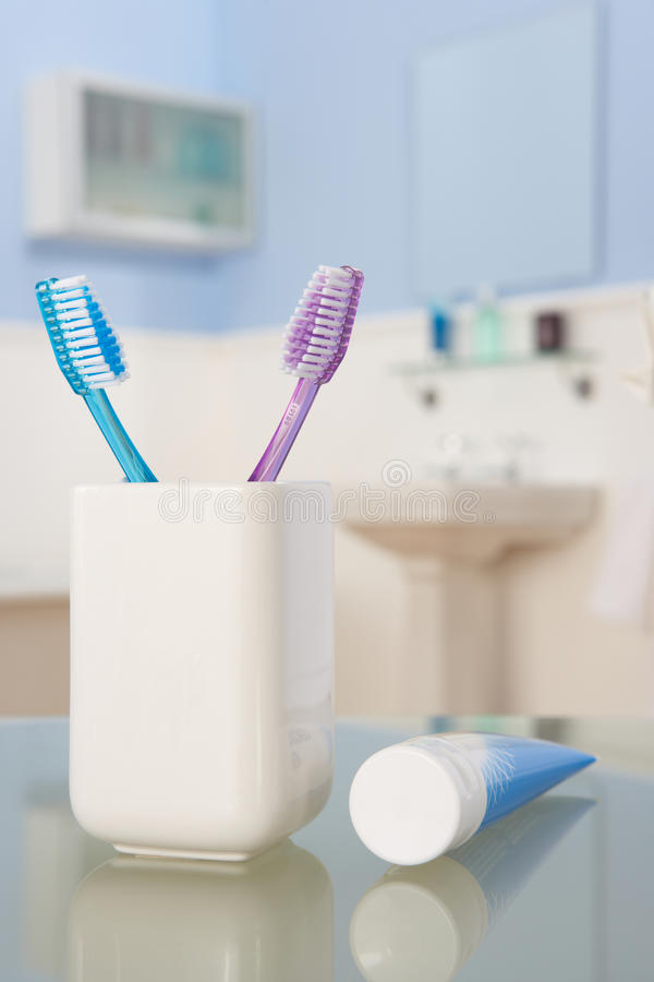 Toothbrushes and toothpaste royalty free stock images