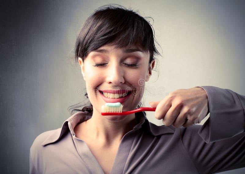 Toothbrushing stock foto