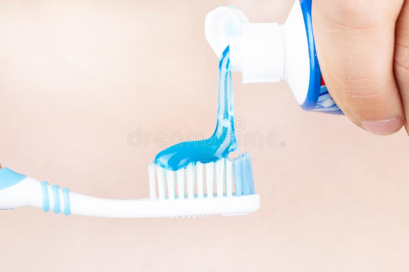 Toothpaste is applied to the toothbrush,tooth brushing  in hand stock photos
