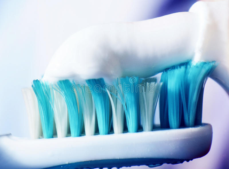 Toothpaste on a brush, macro royalty free stock images