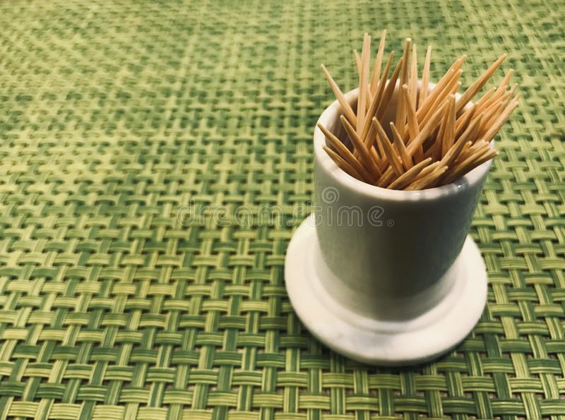 Toothpick on the green tablecloth. In restaurant stock photo