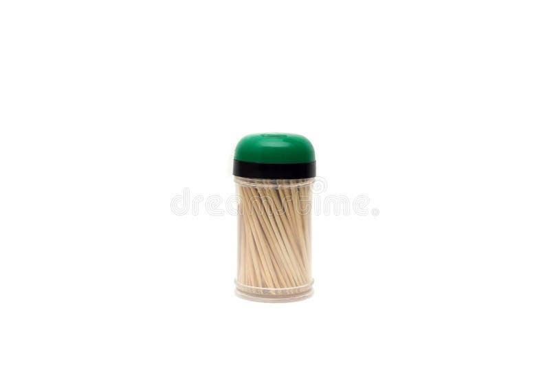 Toothpicks di legno su una priorità bassa bianca immagini stock