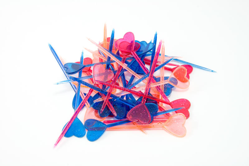 Toothpicks multicolori dei biglietti di S. Valentino fotografie stock
