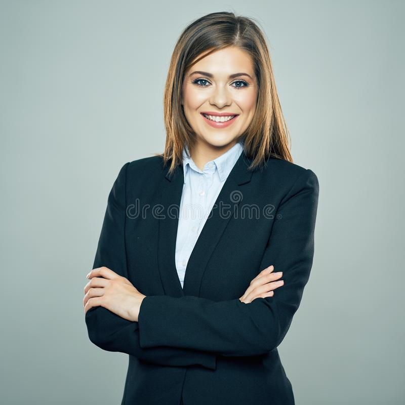 Toothy smiling Business woman crossed arms isolated portrait. Studio isolated royalty free stock image
