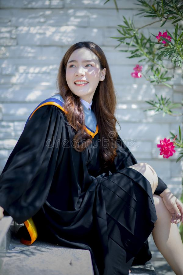 Toothy smiling face of beautiful asian younger woman wearing university graduated clothes happiness emotion royalty free stock photo