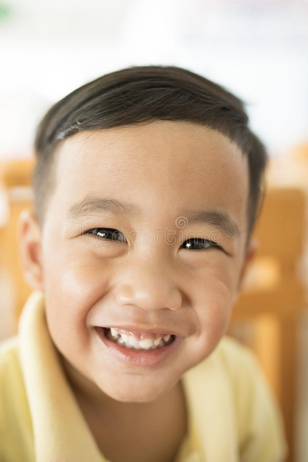 Toothy smiling face happiness emotion of asian children shallow stock photos