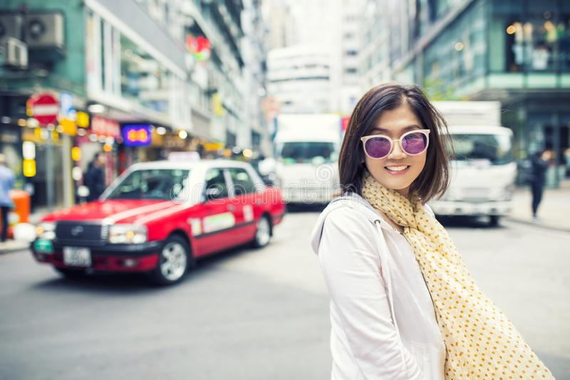 Toothy smiling face happiness emotion of asian woman standing on hongkong city street stock image