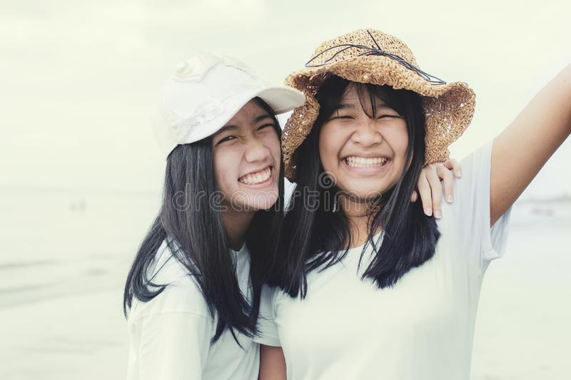 Toothy smiling face of two asian teenager happiness emotion stock photography