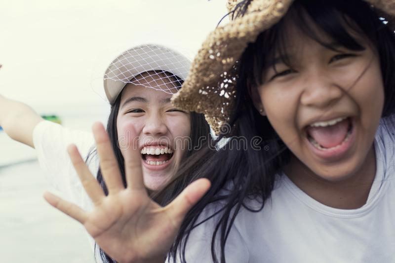Toothy smiling face of two asian teenager happiness emotion royalty free stock photos