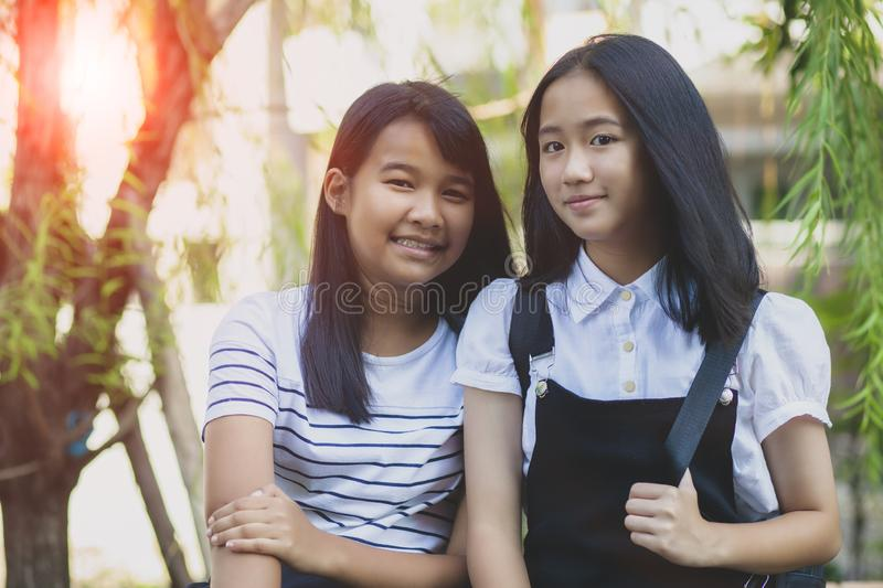Toothy smiling face of two asian teenager standing outdoor. Toothy smiling face of two asian   teenager standing outdoor royalty free stock photo
