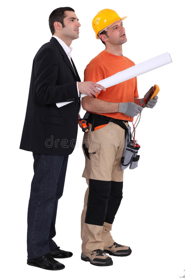 Topógrafo e construtor imagens de stock