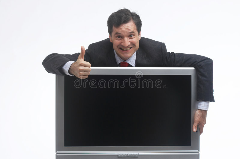 Top. Salesmann grabbing an TV- screen and showing the thumbs-up sign royalty free stock photography