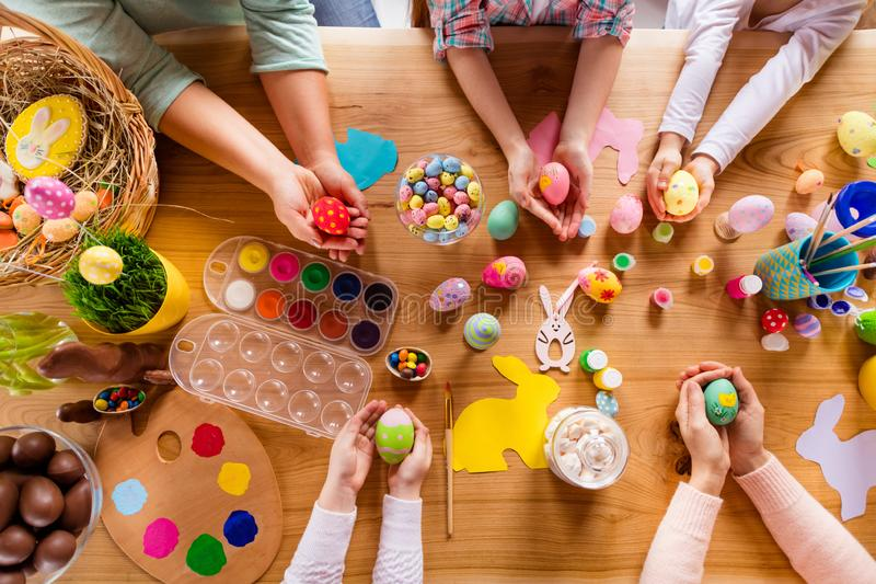 Top above high angle cropped view of work place table group of people ladies housewives holding in hands colorful modern royalty free stock photos