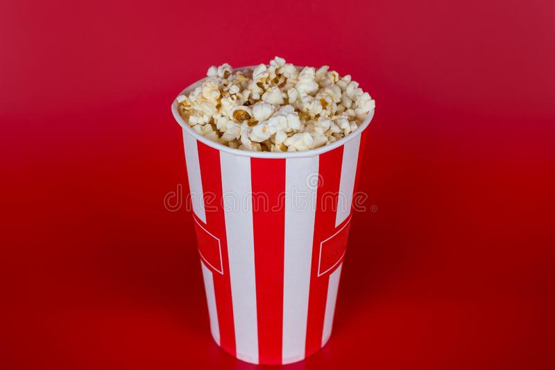 Top above high angle overhead close up view photo of tasty fresh delicious yummy sweet sugary salty popcorn isolated over bright stock images