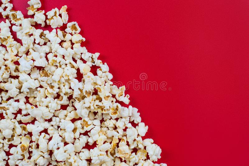 Top above high angle overhead closeup view photo of tasty delicious yummy popcorn with copy space place for design isolated over. Bright color background stock photos