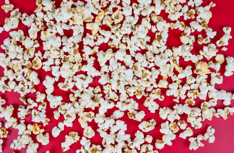 Top above high angle overhead closeup view photo of tasty popcorn isolated over vivid color background.  royalty free stock photo