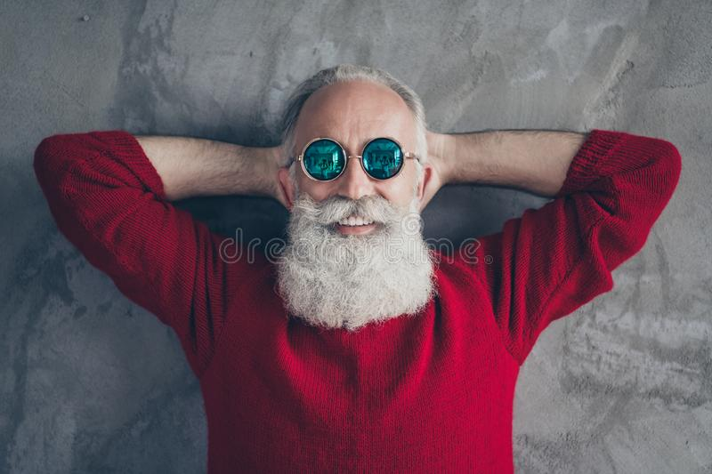 Top above high angle photo of positive festive old man relax day dream enjoy christmas time wear trendy jumper isolated royalty free stock images