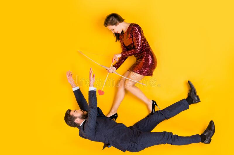 Top above high angle view full body photo of two students people cunning girl shoot aim cupid arrow shocked man fall. Top above high angle view full body photo stock photo