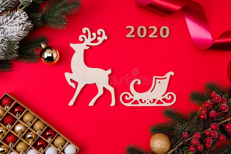 Top above high angle view photo of deer reindeer with sleigh behind surrounded toys branches berries 2020 isolated. Top above high angle view photo of deer stock photos