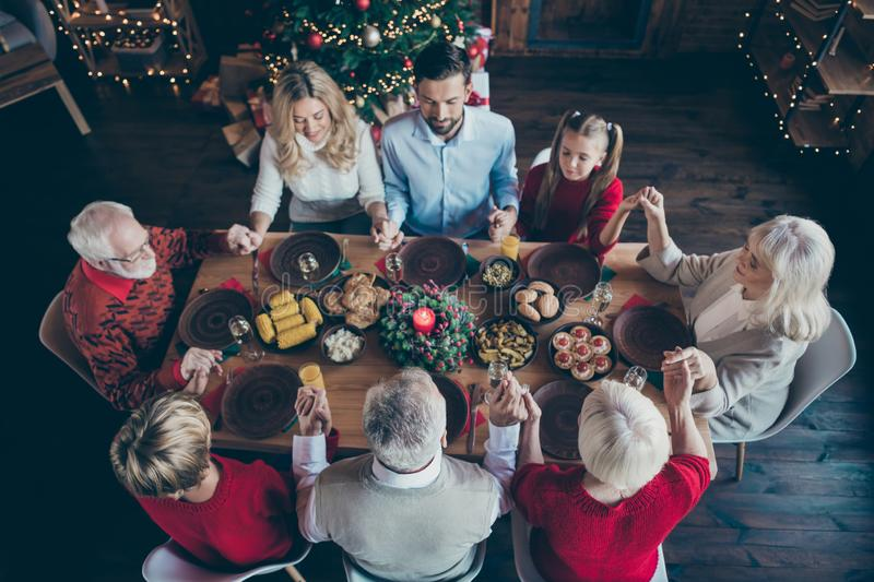Top above and high angle view photo of large family having gathered to spend new year together grandchildren. Grandparents, son and daughter wife husband hold stock photography
