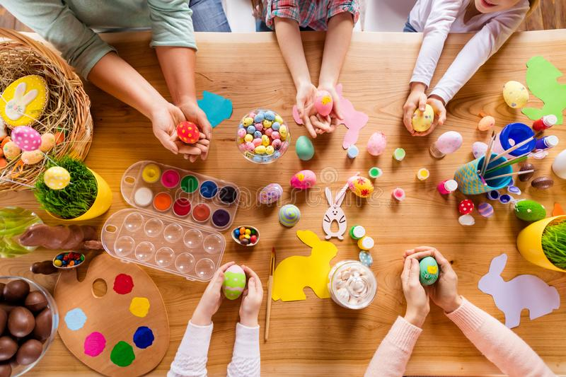 Top above high angle view of work place table group of people gathering meeting holding in hands colorful modern stock images