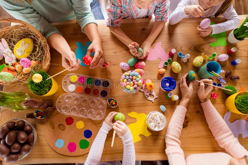 Top above high angle view of work place table group of people hands doing making dying modern decor accessory things stock image