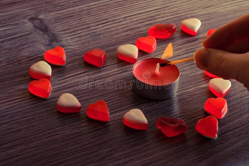 Top above overhead close up photo of beautiful lovely tasty sugary sweet nice heart and candle. Jelly candies in shape of beautifu. L heart with candle flame stock images