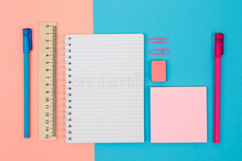 Top above overhead close up view photo of pretty beauitful nice school accessories half pink half blue. Universitry student pupil stock image