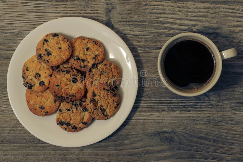 Top above overhead close up view photo of tasty yummy crunchy with chocolate homemade cookies on white kitchen crockery plate a cu stock images