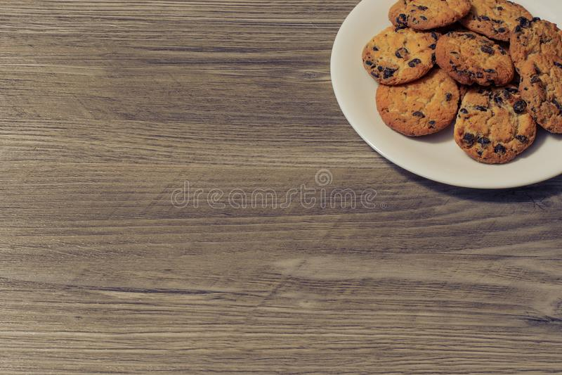 Top above overhead close up view photo of tasty yummy delicious crunchy crispy cookies with chocolate on whute round plate isolate stock photos
