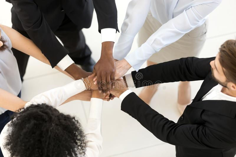 Top above view diverse business people stacked hands stock photo