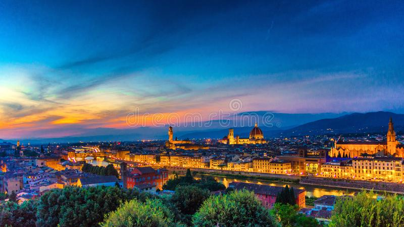 Top aerial panoramic evening view of Florence city with Duomo Santa Maria del Fiore cathedral, Arno river royalty free stock image