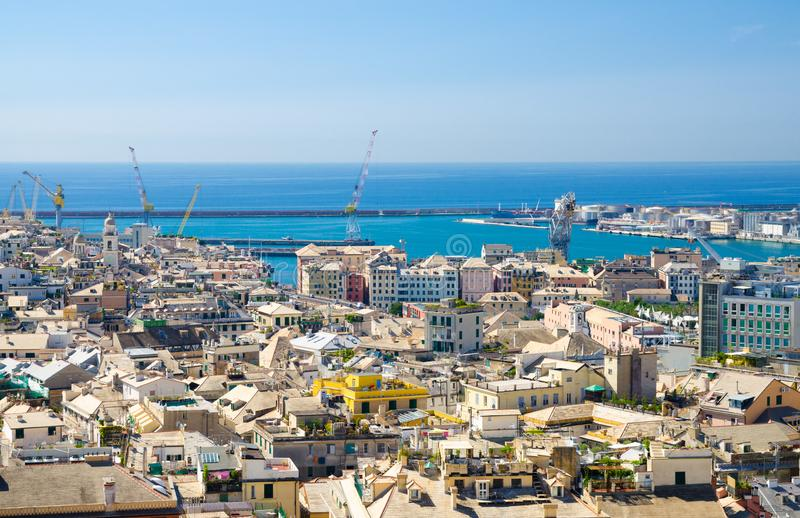 Top aerial scenic panoramic view from above of old historical centre quarter districts of european city Genoa. Genova, port and harbor of Ligurian and stock photos