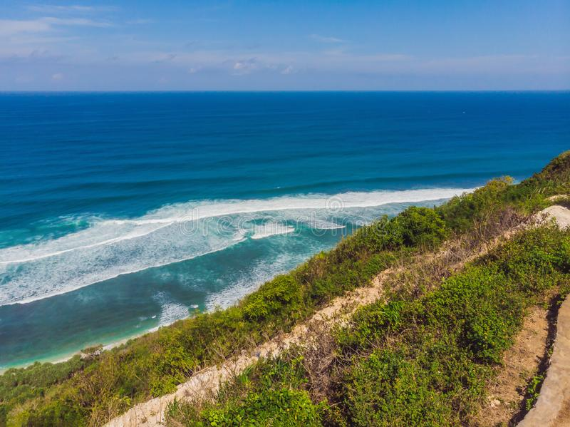 Top aerial view of beauty Bali beach. Empty paradise beach, blue sea waves in Bali island, Indonesia. Suluban and Nyang. Nyang place stock images