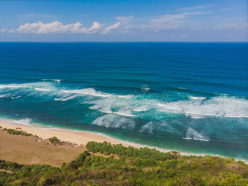 Top aerial view of beauty Bali beach. Empty paradise beach, blue sea waves in Bali island, Indonesia. Suluban and Nyang. Nyang place royalty free stock photo
