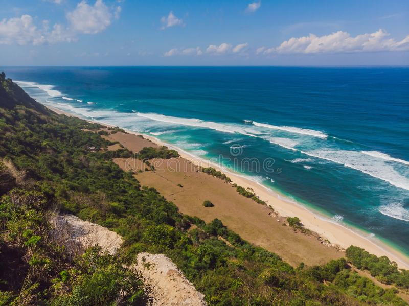 Top aerial view of beauty Bali beach. Empty paradise beach, blue sea waves in Bali island, Indonesia. Suluban and Nyang. Nyang place royalty free stock images