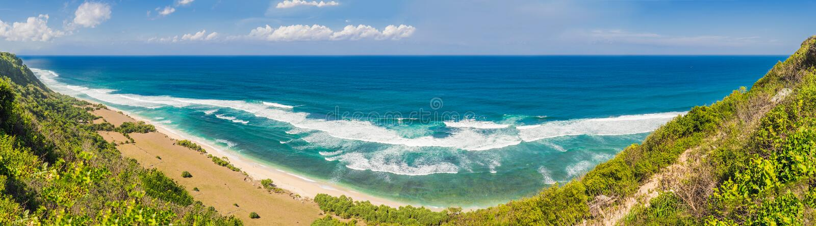 Top aerial view of beauty Bali beach. Empty paradise beach, blue sea waves in Bali island, Indonesia. Suluban and Nyang. Nyang place stock photography